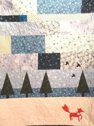 Snowflake and fox quilt